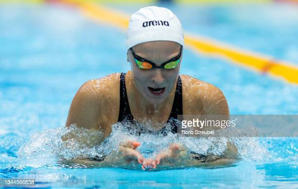Maria Ugolkova of Suisse competes in the women's 200m individual medley heat during day three of the FINA Swimming World Cup Berlin at Schwimm- und...