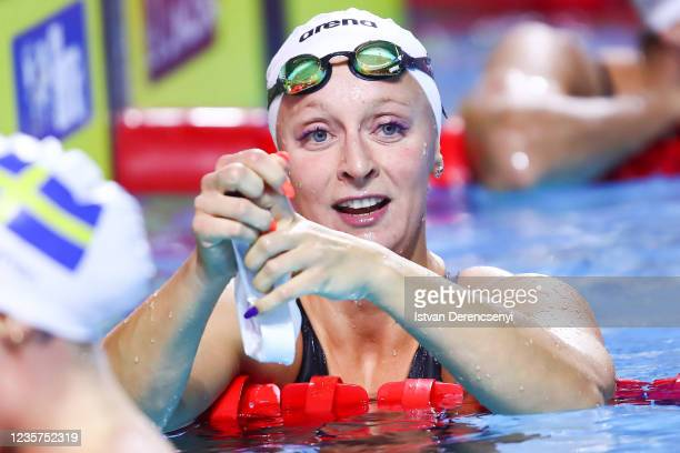 Maria Ugolkova of Switzerland reacts after the race in the women's medley 100m final on day one at the FINA Swimming World Cup in the Duna Arena on...
