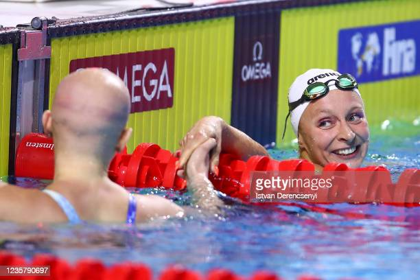 Maria Ugolkova of Switzerland reacts after the race in the womens medley 200m final on day three at the FINA Swimming World Cup in the Duna Arena on...