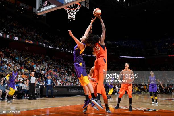 Maria Vadeeva of the Los Angeles Sparks and Jonquel Jones of the Connecticut Sun reach for the rebound on August 19 2018 at the Mohegan Sun Arena in...