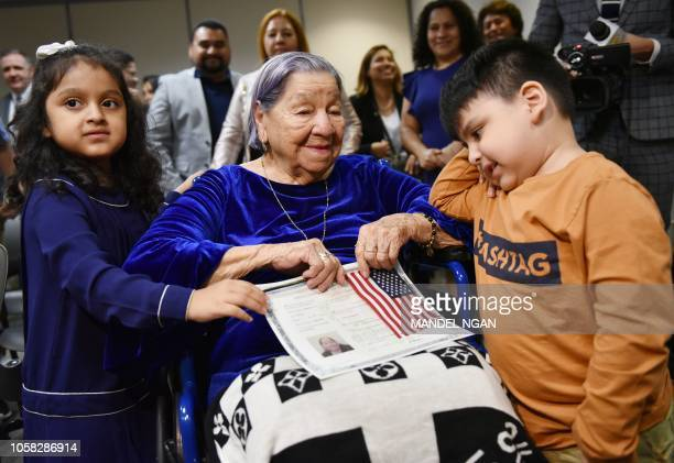 Maria Valles Bonilla is seen with her greatgrandchildren Asia Cortes and Josh Cortes after becoming a US citizen during a naturalization ceremony at...