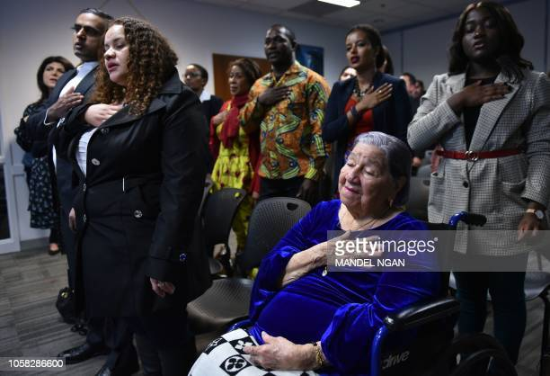 Maria Valles Bonilla takes her citizenship oath at the US Citizenship and Immigration Services Washington District Office in Fairfax Virginia on...