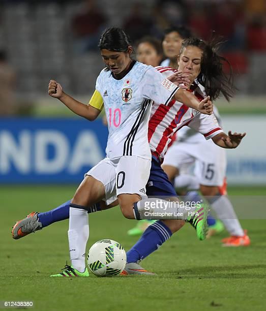 Maria Vecca of Paraquay stops Fuka Nagano of Japan during the FIFA U17 Women's World Cup Jordan 2016 Group D match between Paraquay and Japan at King...