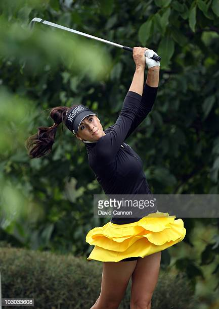 Maria Verchenova of Russia plays her tee shot at the par 3 8th hole from the bushes behind the green during the first round of the 2010 Evian Masters...