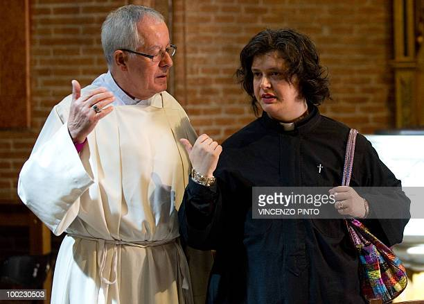 Maria Vittoria Longhitano a 35 yearsold married teacher from Milan talks with Monsignor Fritz ReneMuller prior her ordination as Italy's first women...