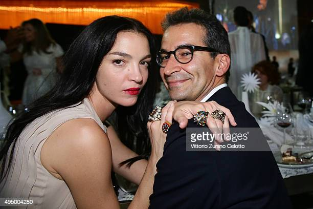 Mariacarla Boscono and CEO of Yoox Federico Marchetti attend the Gala event during the Vogue Fashion Dubai Experience 2015 at Armani Hotel Dubai on...