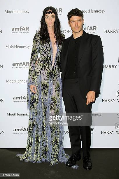 Mariacarla Boscono and Jacob K attend the amfAR dinner at the Pavillon LeDoyen during the Paris Fashion Week Haute Couture on July 5 2015 in Paris...