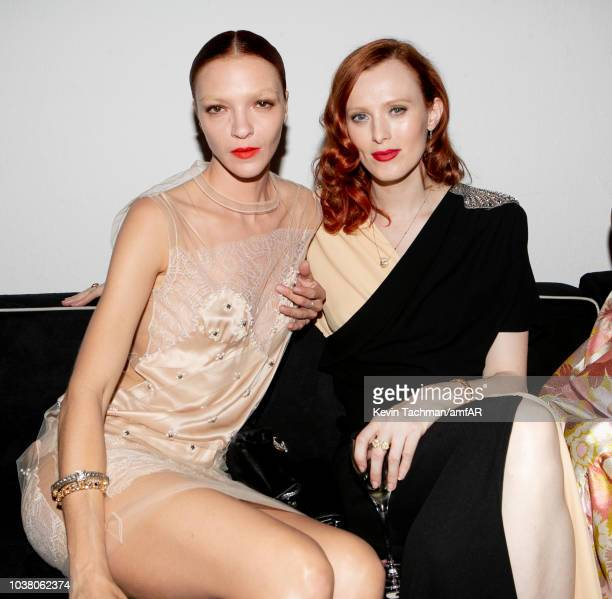 Mariacarla Boscono and Karen Elson are seen during the cocktail reception of amfAR Gala at La Permanente on September 22 2018 in Milan Italy