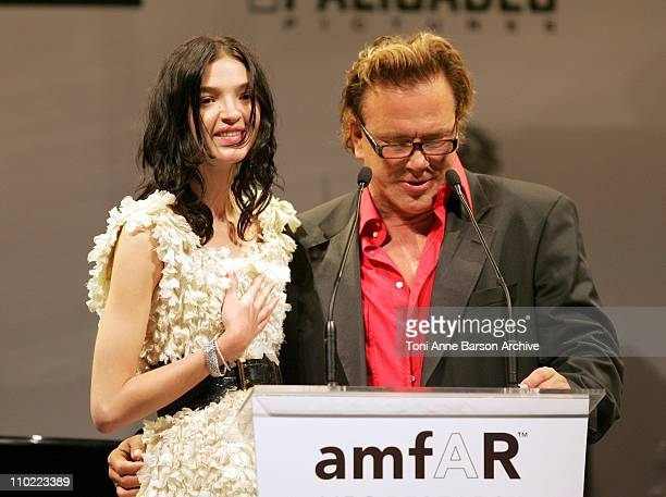 "Mariacarla Boscono and Mickey Rourke during amfAR ""Cinema Against AIDS"" Gala Presented By Miramax Films, Palisades Pictures and Quintessentially -..."