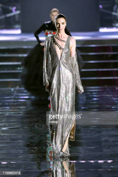 Mariacarla Boscono walks the CR Runway x LuisaViaRoma at Piazzale Michelangelo during the Pitti Immagine Uomo 96 on June 13 2019 in Florence Italy