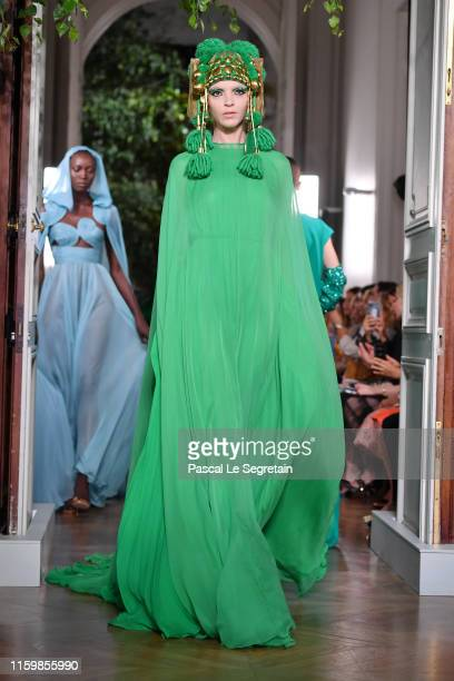 Mariacarla Boscono walks the runway during the Valentino Fall/Winter 2019 2020 show as part of Paris Fashion Week on July 03, 2019 in Paris, France.