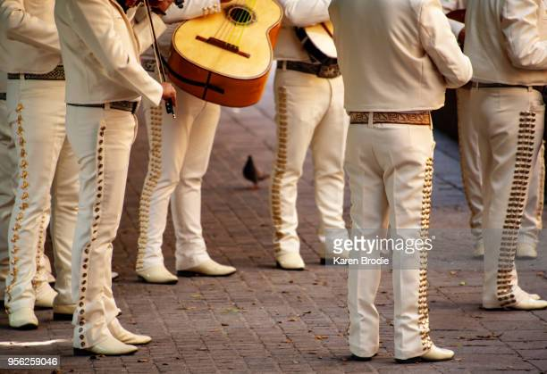 mariachi band entertaining in a public square - mariachi stock pictures, royalty-free photos & images