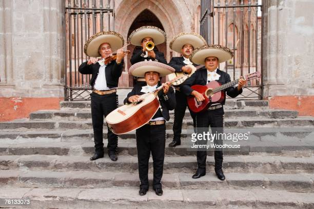 mariachi band in front of cathedral - mariachi stock pictures, royalty-free photos & images