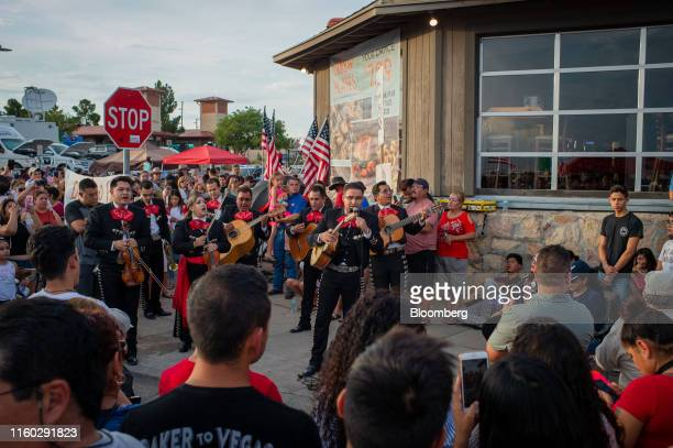 Mariachi band performs as mourners gather for a vigil at a memorial outside Cielo Vista Walmart in El Paso, Texas, U.S., on Wednesday, Aug. 7, 2019....