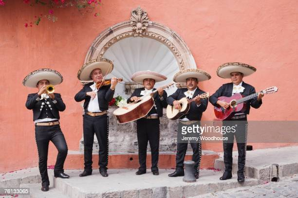 mariachi band playing in front of fountain - mexican hat stock pictures, royalty-free photos & images