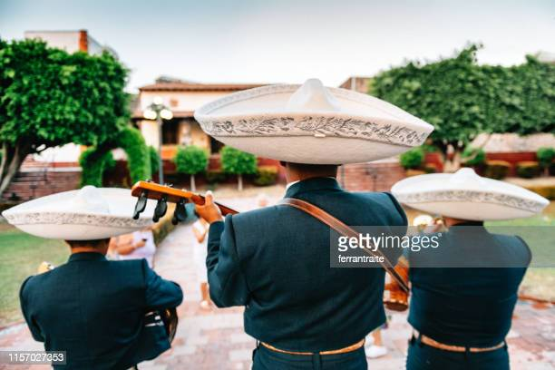 mariachi band playing - cinco de mayo stock pictures, royalty-free photos & images