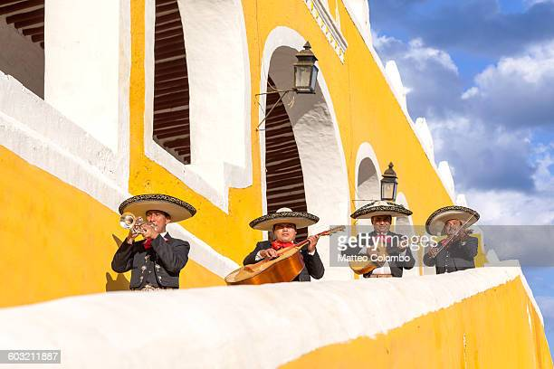 mariachi group in izamal, yucatan, mexico - mexican hat stock pictures, royalty-free photos & images