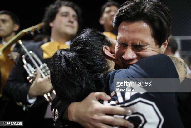 Mariachi player and El Paso resident Sebastian Gonzalez , hugs a woman at the conclusion of an interfaith vigil for victims of a mass shooting, which...