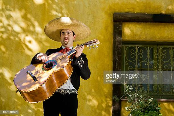 mariachi playing guitar - guadalajara mexico stock pictures, royalty-free photos & images