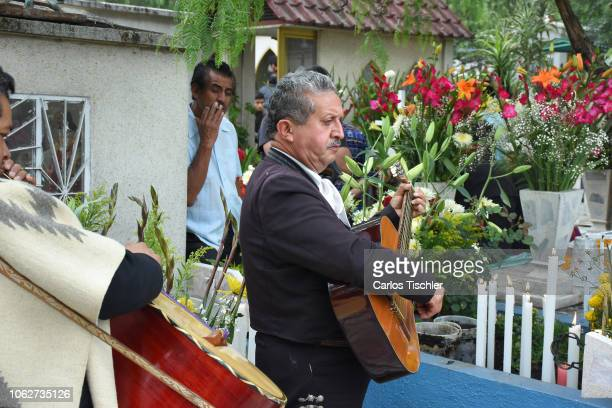 Mariachi plays the Guitar as part of the Day Of The Dead celebrations at Cemetery of Iztapalapa on November 02 2018 in Mexico City Mexico