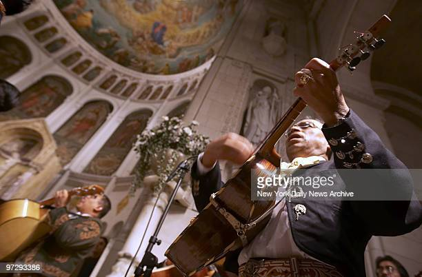Mariachis play during a mass commemorating Saint Cecilia the patron saint of musicians and Church music at Basilica of Our Lady of Perpetual Help in...