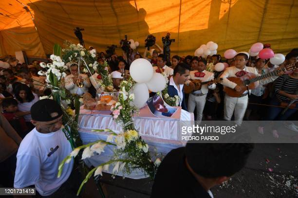 Mariachis sing and play music before the coffin of a sevenyearold girl whose body was found over the weekend with signs of torture is carried to the...