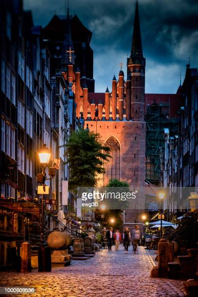 mariacka street in old town by night, gdansk, poland - gdansk stock pictures, royalty-free photos & images