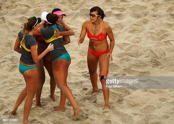 Mariafe Artacho del Solar and Nicole Laird of Australia are embraced by Fan Wang and Yuan Yue of China after being defeated during their Women's...
