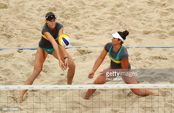 Mariafe Artacho del Solar and Nicole Laird of Australia vie against Fan Wang and Yuan Yue of China during their Women's Preliminary Pool C match on...