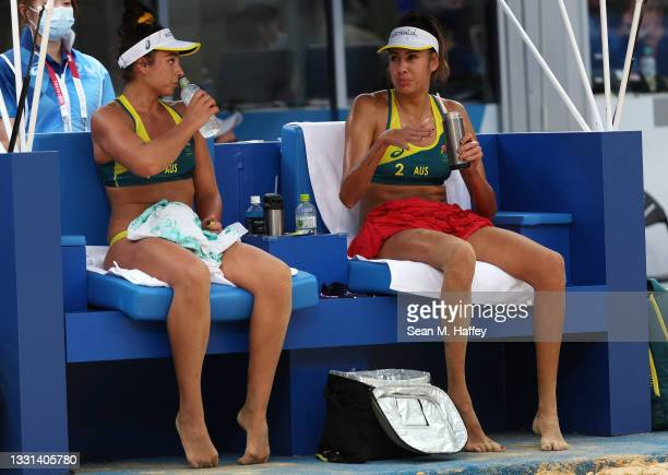 Mariafe Artacho del Solar and Taliqua Clancy of Team Australia react as they compete against Team ROC during the Women's Preliminary - Pool E beach...