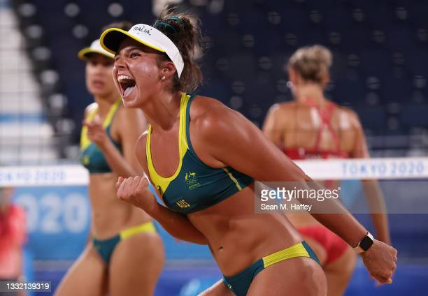 Mariafe Artacho del Solar and Taliqua Clancy of Team Australia react as they compete against Team Canada during the Women's Quarterfinal beach...