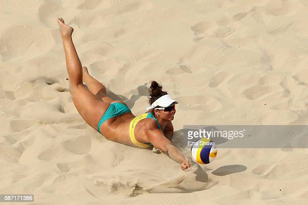 Mariafe Artacho del Solar of Australia dives during the Women's Beach Volleyball preliminary round Pool C match against Isabelle Forrer and Anouk...
