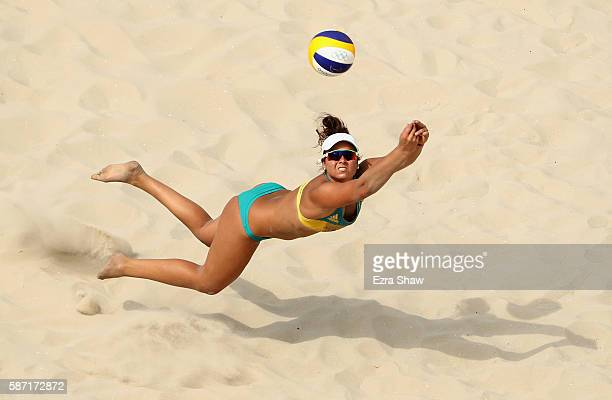 Mariafe Artacho del Solar of Australia dives during the Women's Beach Volleyball preliminary round Pool C match against Anouk VergeDepre and Isabelle...