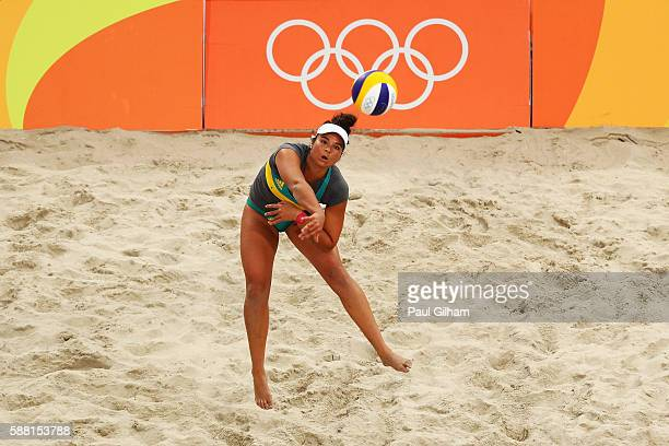 Mariafe Artacho del Solar of Australia vies against Fan Wang and Yuan Yue of China during their Women's Preliminary Pool C match on Day 5 of the Rio...