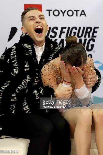 Mariah Bell reacts with coach Adam Rippon to her scores after skating in the Ladies Free skate during the 2020 US Figure Skating Championships at...