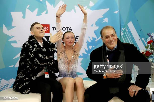 Mariah Bell reacts with coaches Adam Rippon and Rafael Arutyunyan to her scores after skating in the Ladies Free skate during the 2020 US Figure...