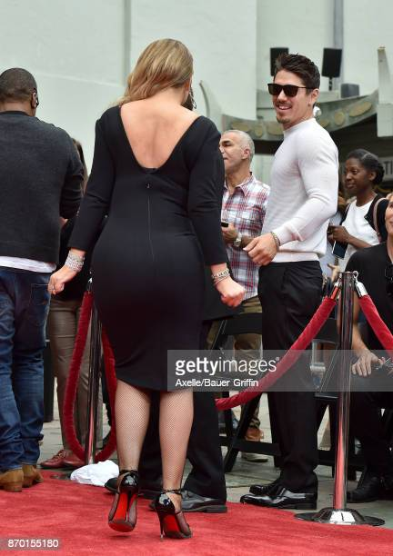 Mariah Carey and Bryan Tanaka attend the Hand and Footprint Ceremony honoring Mariah Carey at TCL Chinese Theatre on November 1 2017 in Hollywood...