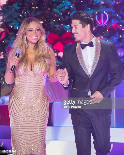 Mariah Carey and Bryan Tanaka live on stage at The O2 Arena on December 11 2017 in London England