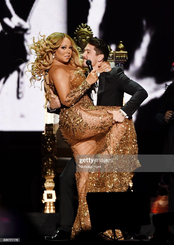 Mariah Carey and Bryan Tanaka perform in Concert - New York, New York at Madison Square Garden on August 19, 2017 in New York City.