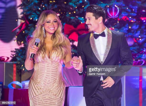 Mariah Carey and Bryan Tanaka perform live on stage at The O2 Arena on December 11 2017 in London England