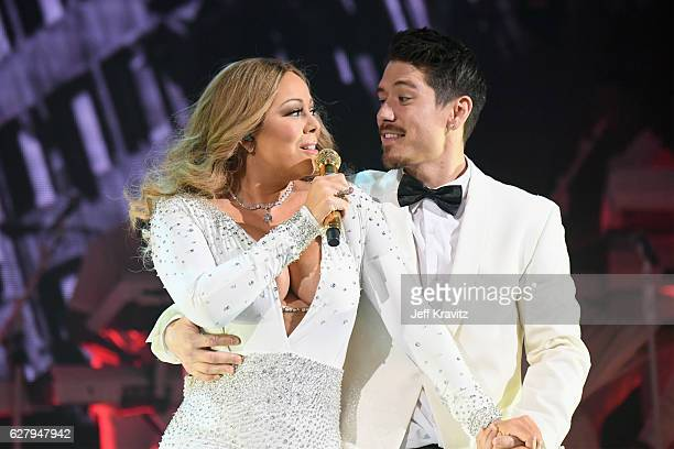 Mariah Carey and dancer Bryan Tanaka perform during the opening show of Mariah Carey All I Want For Christmas Is You at Beacon Theatre on December 5...