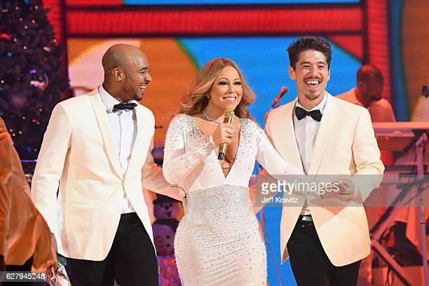 Mariah Carey and dancers Anthony Burrell and Bryan Tanaka perform during the opening show of Mariah Carey All I Want For Christmas Is You at Beacon...