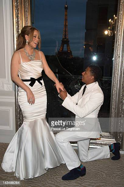 Mariah Carey and her husband Nick Cannon during their wedding vows renewal ceremony photocall on April 27 2012 in Paris France