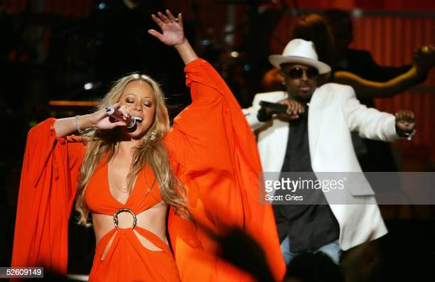 Mariah Carey and Jermaine Dupri perform onstage during a taping for the VH1 Save The Music Foundation benefit concert at the Beacon Theater April 9...
