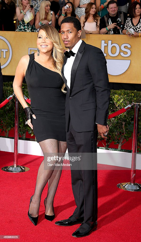 Mariah Carey and Nick Cannon (R) arrive at the 20th Annual Screen Actors Guild Awards at the Shrine Auditorium on January 18, 2014 in Los Angeles, California.