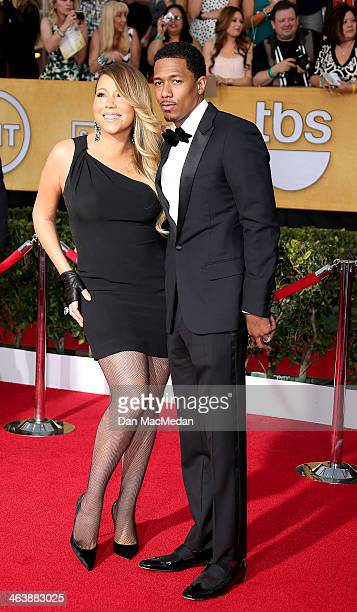 Mariah Carey and Nick Cannon arrive at the 20th Annual Screen Actors Guild Awards at the Shrine Auditorium on January 18 2014 in Los Angeles...