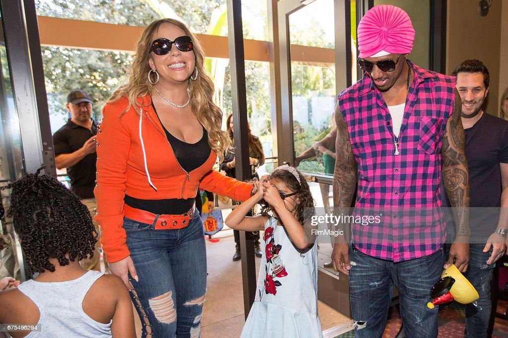 Mariah Carey (L) and Nick Cannon arrive at their childrens birthday party at Disneyland on April 30, 2017 in Anaheim, California.