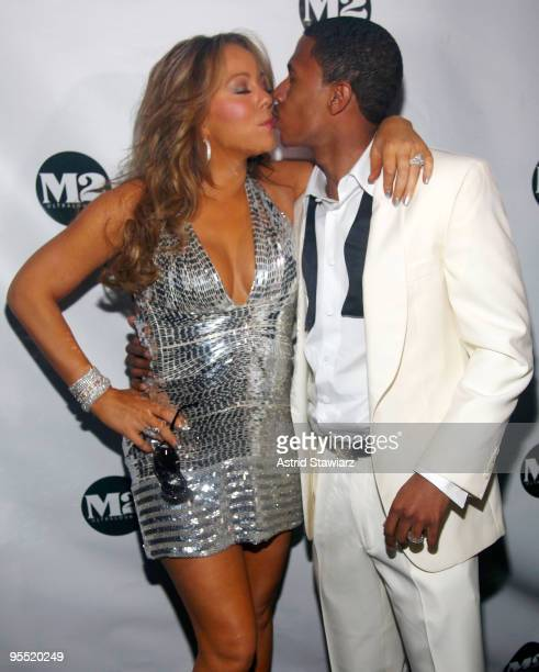Mariah Carey and Nick Cannon pose for photos inside a New Years Eve celebration at M2 Ultra Lounge on December 31 2009 in New York City