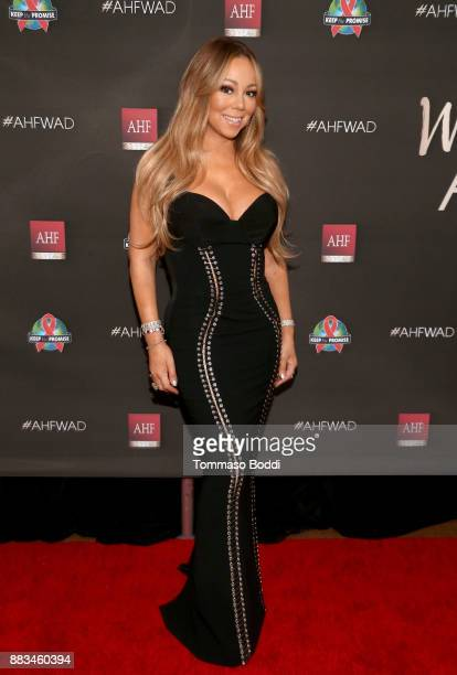 Mariah Carey attends the AHF World AIDS DAY Concert and 30th Anniversary Celebration featuring Mariah Carey and DJ Khaled at the Shrine Auditorium on...