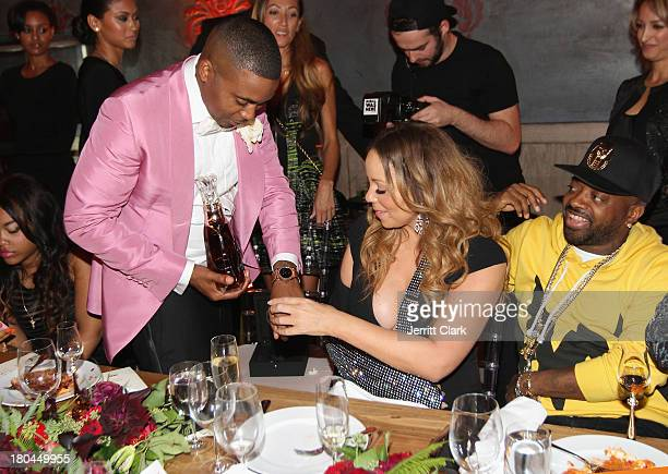Mariah Carey checks out Nas' Hublot Classic Fusion watch as Jermaine Dupri looks on at Nas 40th Birthday Celebration Dinner And Party at Avenue NYC...